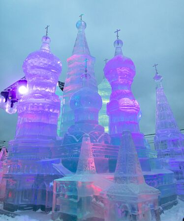 Statue of a church made of ice in a park.