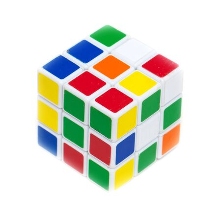 Colored rubik cube isolated on white background. Banco de Imagens