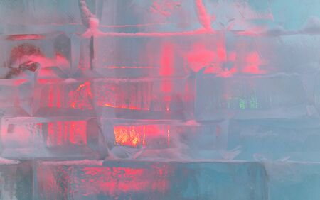 Ice bricks backlit in red as a background.