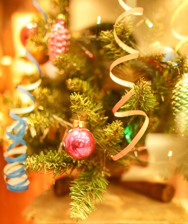 Toys and decorations on the Christmas tree. New Year holiday.