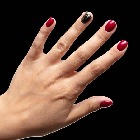 Hands of a girl with red manicure isolated on a black background. 写真素材 - 133582129