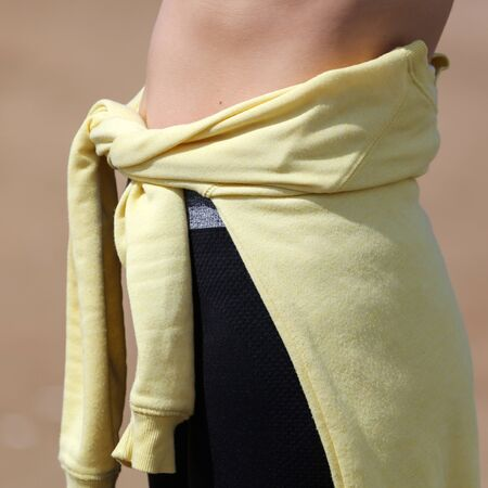 Yellow jacket on the girl's stomach.