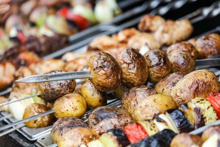 Grilled vegetables with mushrooms and meat.