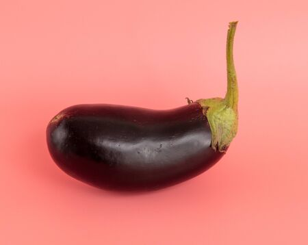 Eggplant isolated on a pink background.