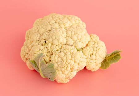 Cauliflower isolated on a pink background. Stock Photo