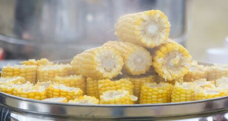 Boiled corn on the counter in the market.