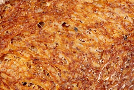 Brown bread crust as an abstract background.