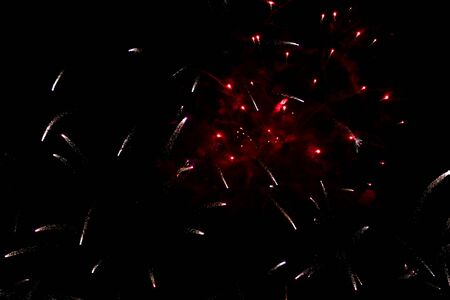 Colorful fireworks in the sky at night as background.
