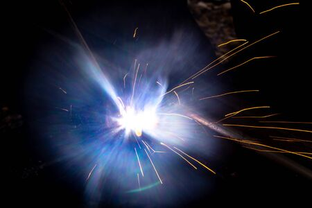 sparks from metal welding at a construction site.