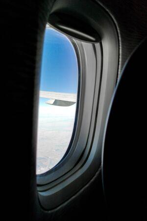Porthole on the plane. Flying in the sky Standard-Bild