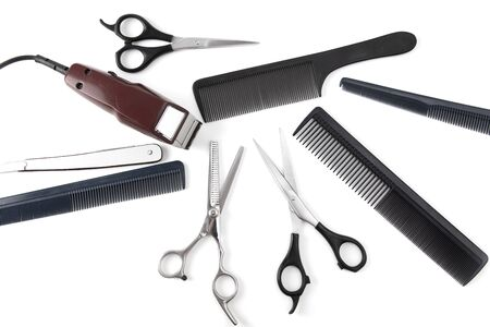 Hair clipper and comb and scissors on a white background.