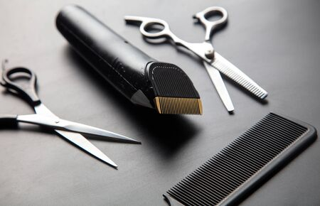 Hair cutting tools on a black background.