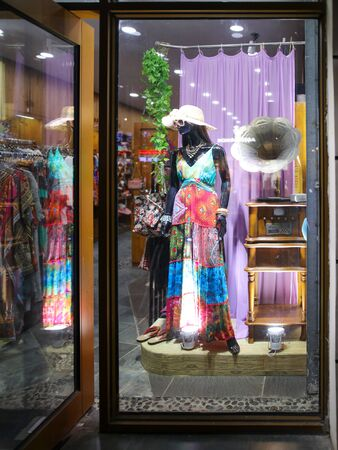 Sanya, Hainan Island, China - January 12, 2020: Mannequin with clothes on a shop window.