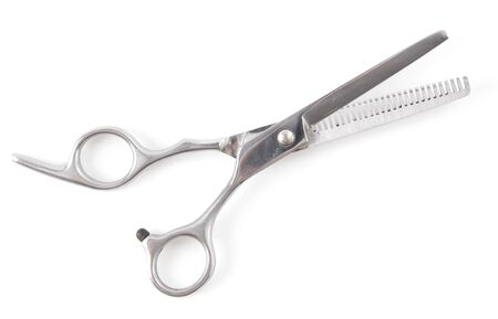 Thinning shears for haircuts isolated on a white background.