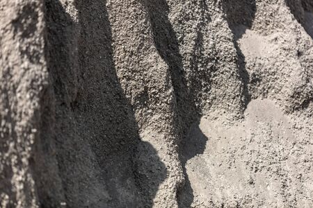 Sand with gravel as a building material. Abstract background.