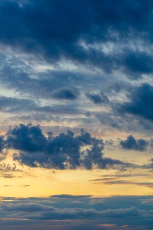 Beautiful clouds at sunset as a background. Stock Photo
