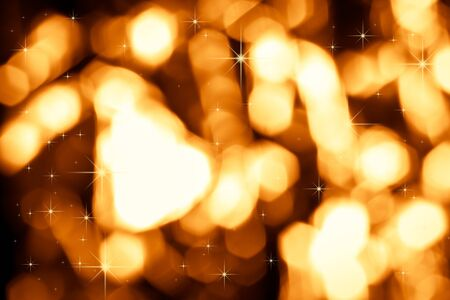 Festive golden bokeh as a texture. Abstract background.