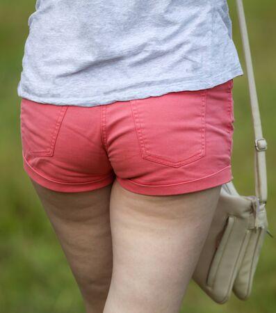 Booty girls in red shorts. Standard-Bild