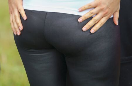 Booty women in black pants.