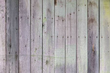 Wooden boards on an old fence as an abstract background. Texture.