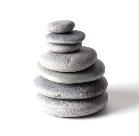 Pyramid of sea stones on a white background.