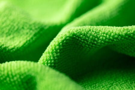 Green fabric as an abstract background. Texture Banque d'images