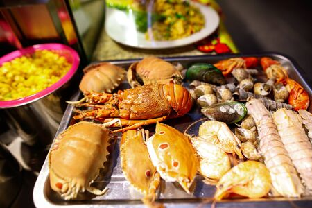 Seafood for frying in oil. Exotic food.