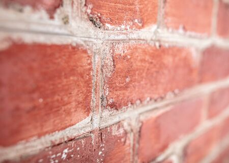 Old red bricks in the wall. Abstract background .