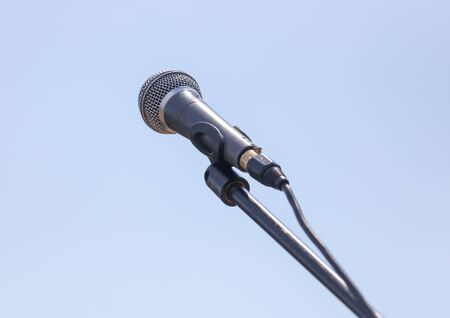 Microphone on a background of blue sky.