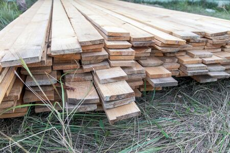 Wooden boards lie on the ground at a construction site at home. Foto de archivo