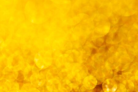 Gold bokeh as abstract background. Texture.