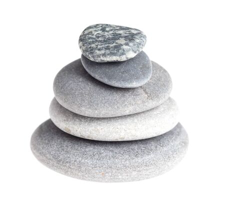 Sea stones isolated on a white background. Pyramid