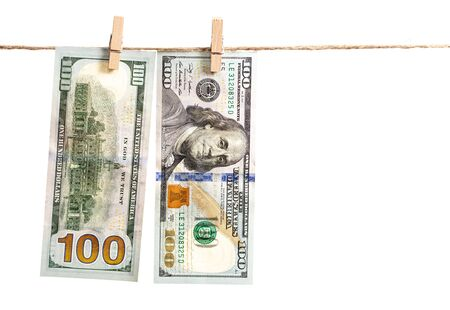Dollars hang on a rope on a white background. 스톡 콘텐츠