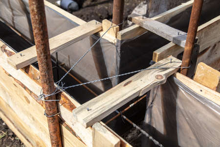 Pouring concrete into the foundation at a home construction site.