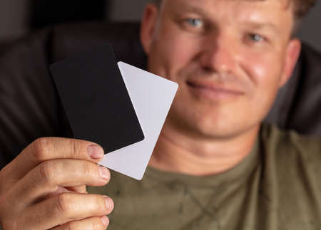 Closeup plastic card in man's hand.