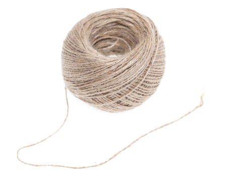A ball of linen thread isolated on a white background. Close-up