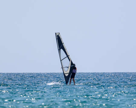 Surfing in the wind at sea. Active sport Stock Photo