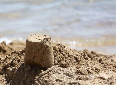 Sand building on the beach by the sea. Reklamní fotografie