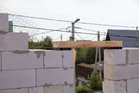 Construction of the walls of the house from foam concrete bricks. Technology 写真素材