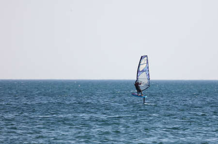Surfing in the wind at sea. Active sport