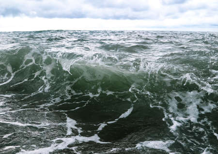 Wave in the sea with splashing water. Abstract background