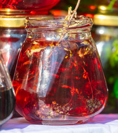 Jam from red leaves in a glass jar. Sweetness