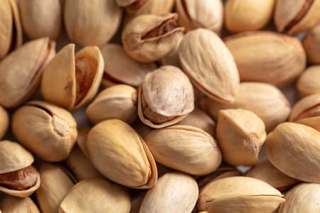 Close-up of fresh pistachio nuts as background. Macro Imagens