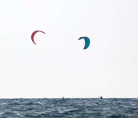The parachute on the board floats in the sea. Sport
