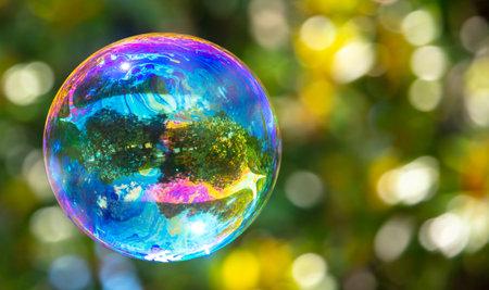 A large soap bubble flies in the park. Nature