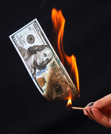 Five hundred Euros burn from a match isolated on a black background. Banco de Imagens - 167321636