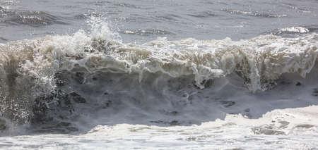 Splashing big waves on the seashore. Storm Banco de Imagens