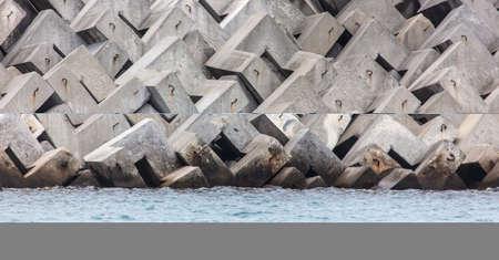 Concrete blocks on the seashore as a background.