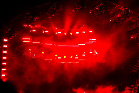 Red light on a rock concert stage as background. Banco de Imagens