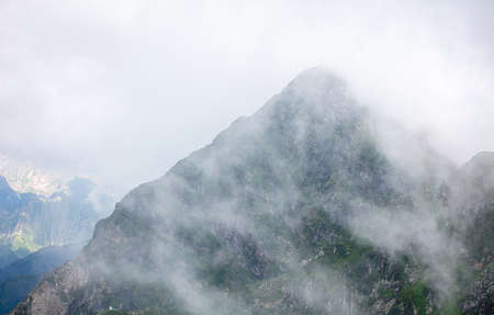 Caucasus mountains in the clouds in summer. Nature Banco de Imagens - 167321757